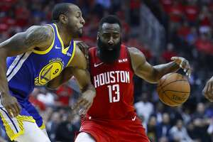 Houston Rockets guard James Harden (13) drives past Golden State Warriors guard Andre Iguodala (9) during the second quarter of Game 3 of a NBA Western Conference semifinal playoff game at Toyota Center, in Houston , Saturday, May 4, 2019.