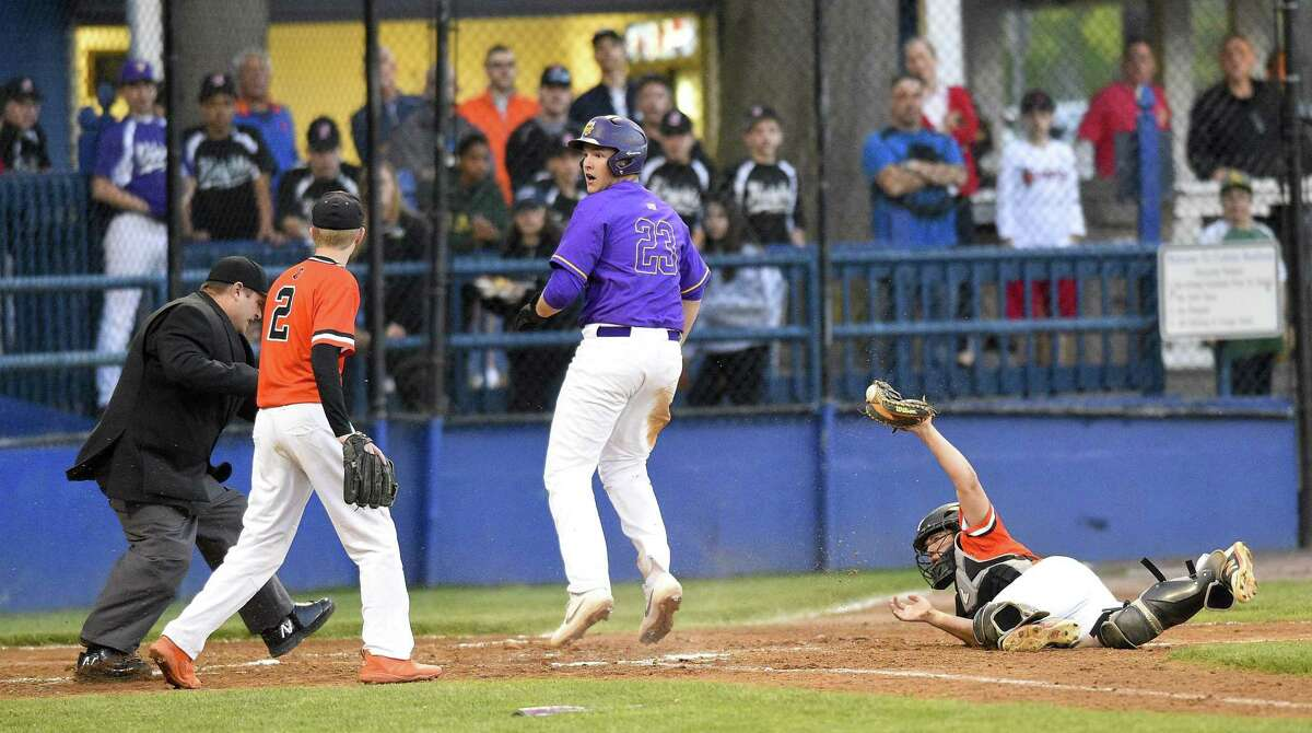 Westhill's Montana Semmel (23) reacts after being tagged out at home plate by Stamford catcher Lucas Wirz (17) in the third inning of a city championship baseball game at Cubeta Stadium on May 8, 2019 in Stamford, Connecticut. Westhill defeated Stamford 6-0, with Semmel on the mound for six innings delivering 11 strikeouts.