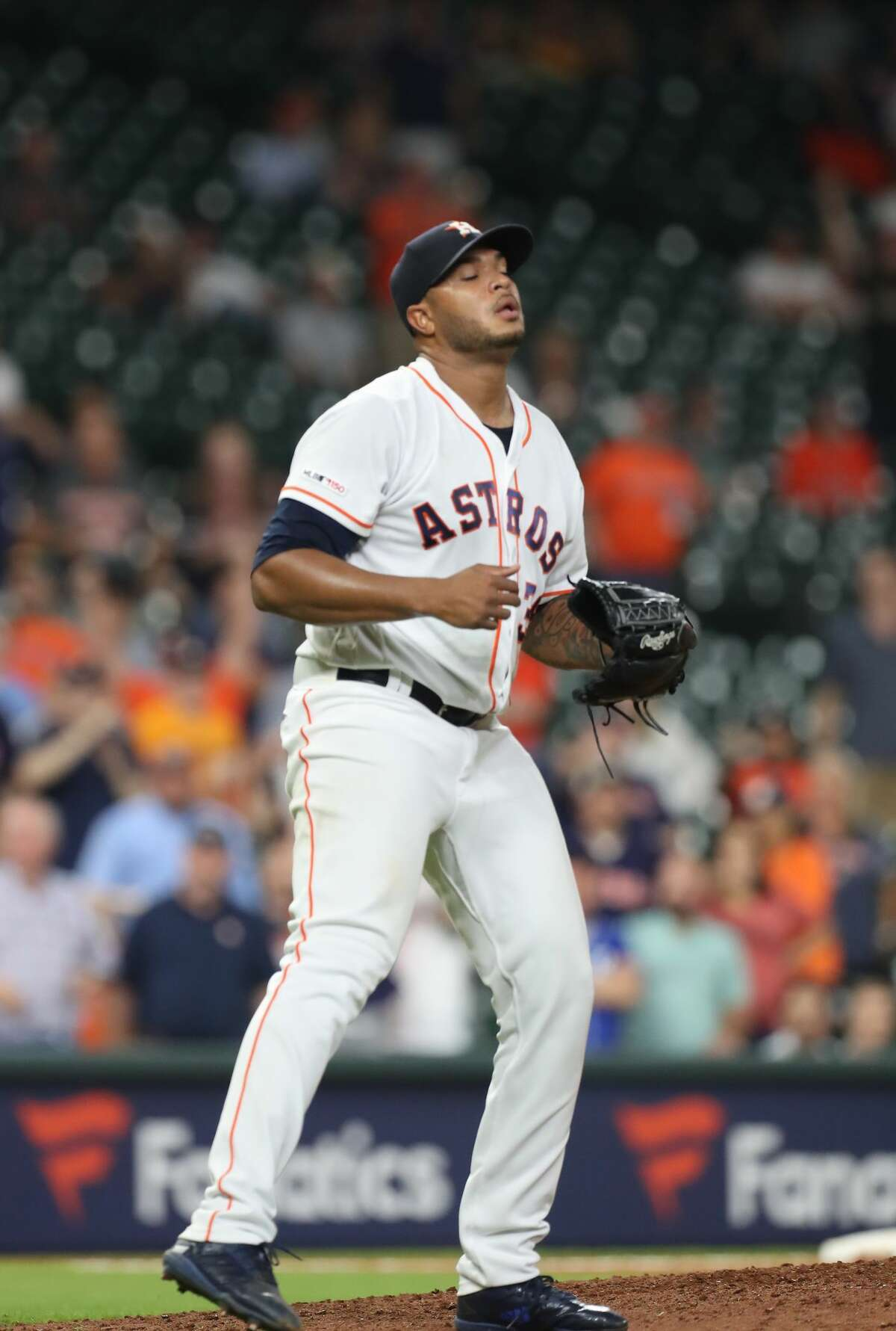 Houston Astros relief pitcher Josh James (39) reacts to making the final out during the an MLB baseball game at Minute Maid Park Wednesday, May 8, 2019, in Houston.
