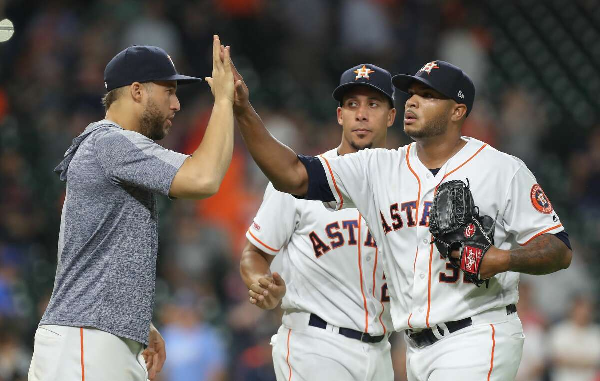 Houston Astros relief pitcher Josh James (39) receives cogrtatulations after making the final out during the an MLB baseball game at Minute Maid Park Wednesday, May 8, 2019, in Houston.