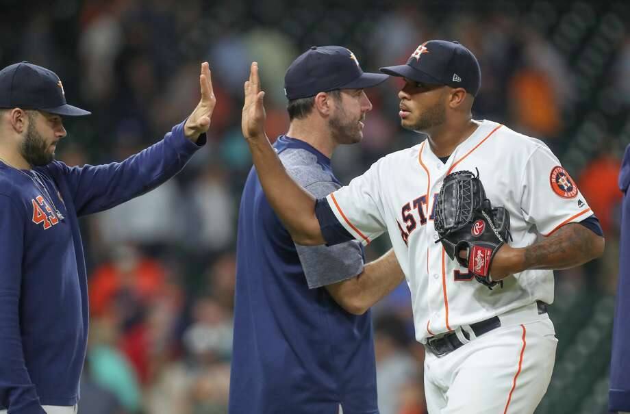 Houston Astros relief pitcher Josh James (39) receives cogrtatulations after making the final out during the an MLB baseball game at Minute Maid Park Wednesday, May 8, 2019, in Houston. Photo: Steve Gonzales/Staff Photographer