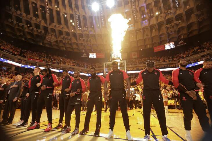 The Houston Rockets line up during the national anthem before Game 5 of the NBA Western Conference semifinals against the Golden State Warriors  at Oracle Arena on Wednesday, May 8, 2019, in Oakland.