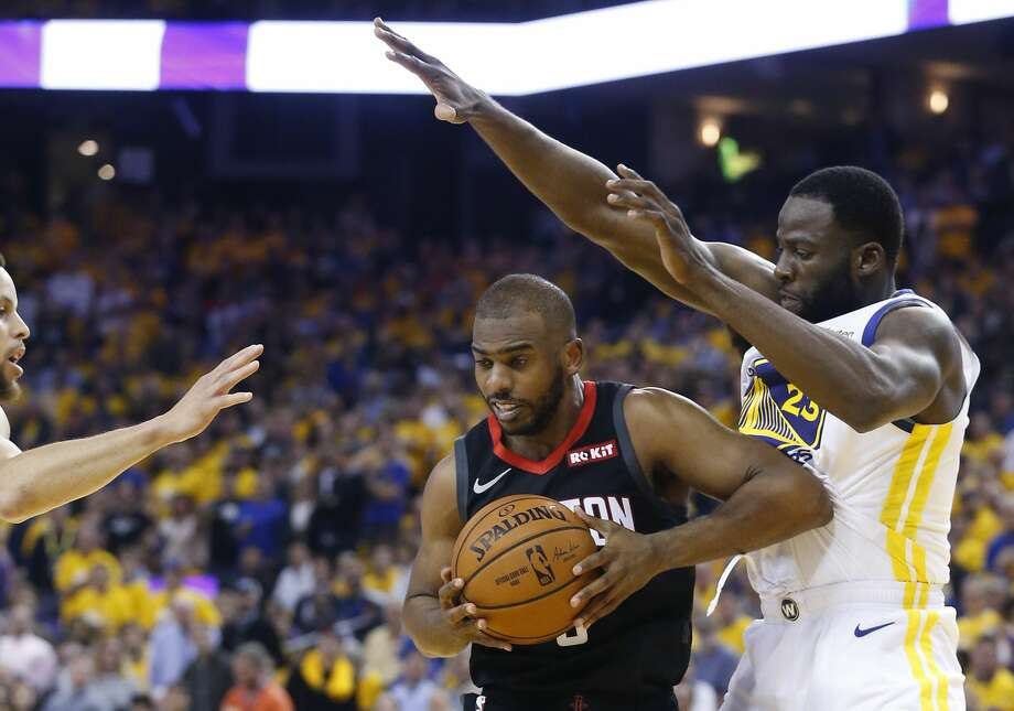 Houston Rockets guard Chris Paul (3) is surrounded by Golden State Warriors guard Stephen Curry, left, and forward Draymond Green (23) during the first half of Game 5 of the NBA Western Conference semifinals at Oracle Arena on Wednesday, May 8, 2019, in Oakland. Photo: Elizabeth Conley/Staff Photographer