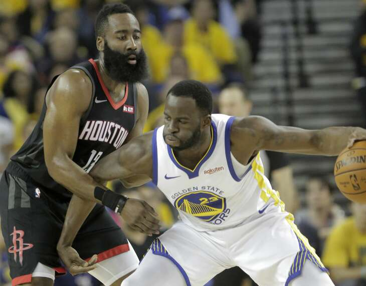 Houston Rockets guard James Harden (13) defends against Golden State Warriors forward Draymond Green (23) during the first half of Game 5 of the NBA Western Conference semifinals at Oracle Arena on Wednesday, May 8, 2019, in Oakland.