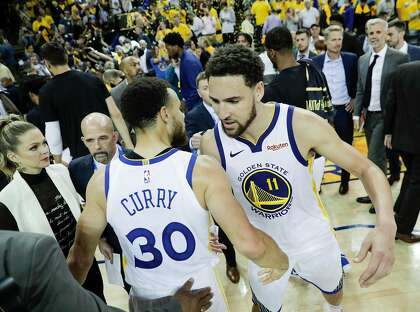 eb57d048db63 Golden State Warriors Stephen Curry and Klay Thompson embrace after the  Warriors  104 to 99 victory over the Houston Rockets in game 5 of the  Western ...