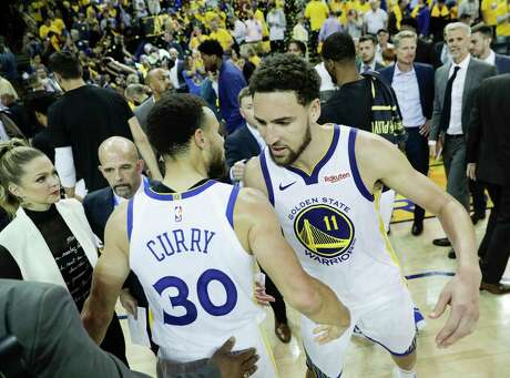 Golden State Warriors Stephen Curry and Klay Thompson embrace after the Warriors' 104 to 99 victory over the Houston Rockets in game 5 of the Western Conference Semifinals between the Golden State Warriors and the Houston Rockets at Oracle Arena on Wednesday, May 8, 2019 in Oakland, Calif.