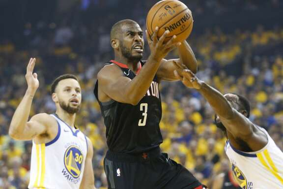 Houston Rockets guard Chris Paul (3) drives to the basket past Golden State Warriors guard Stephen Curry (30) during Game 5 of the NBA Western Conference semifinals at Oracle Arena on Wednesday, May 8, 2019, in Oakland.