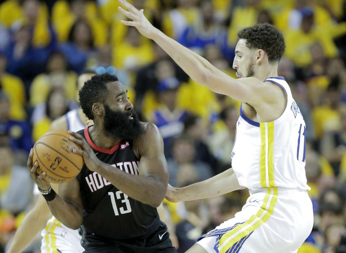 Houston Rockets guard James Harden (13) looks to dish off the ball as Golden State Warriors guard Klay Thompson (11) plays defense during Game 5 of the NBA Western Conference semifinals at Oracle Arena on Wednesday, May 8, 2019, in Oakland.