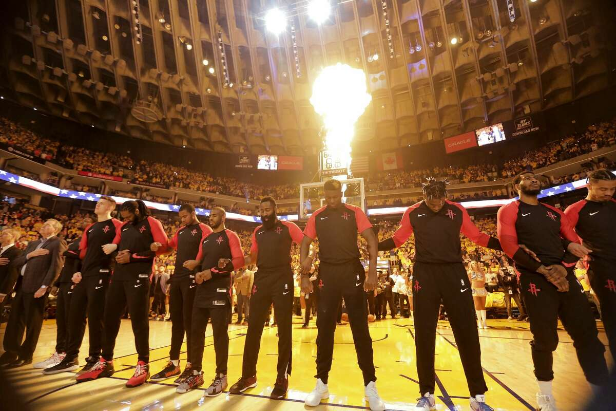 Houston Rockets line up for the National Anthem before Game 5 of the NBA Western Conference semifinals against Golden State Warriors at Oracle Arena on Wednesday, May 8, 2019, in Oakland.