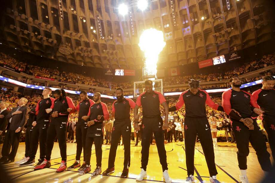 Houston Rockets line up for the National Anthem before Game 5 of the NBA Western Conference semifinals against Golden State Warriors at Oracle Arena on Wednesday, May 8, 2019, in Oakland. Photo: Elizabeth Conley/Staff Photographer