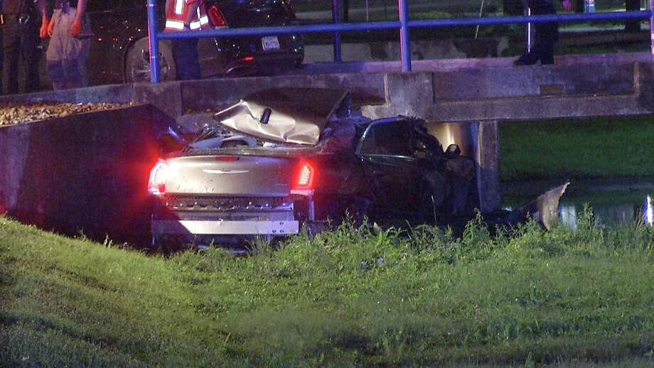 The driver, a man in his 30s, was traveling westbound on the Interstate 10 access road between De Zavala and UTSA Boulevard when he left the roadway, drove into a ditch and smashed into the culvert. Photo: Ken Branca