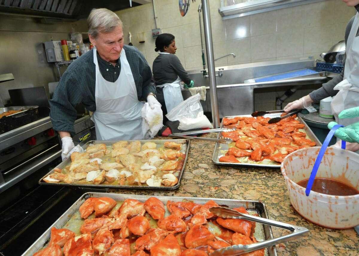 Volunteer Doug Robinson, of Westport, helps prepare Christmas Eve dinners at the Open Doors Shelter in 2017.