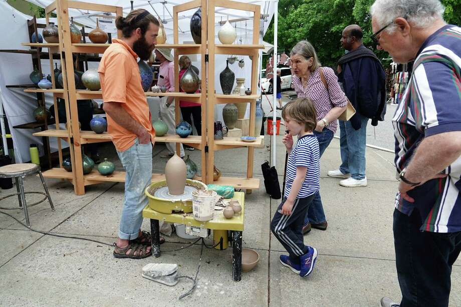 The Bruce Museum hosts its 34th annual Outdoor Crafts Festival on the grounds of the Greenwich site May 18 and 19. Above is a scene from last year's event. Photo: The Bruce Museum / Contributed Photo