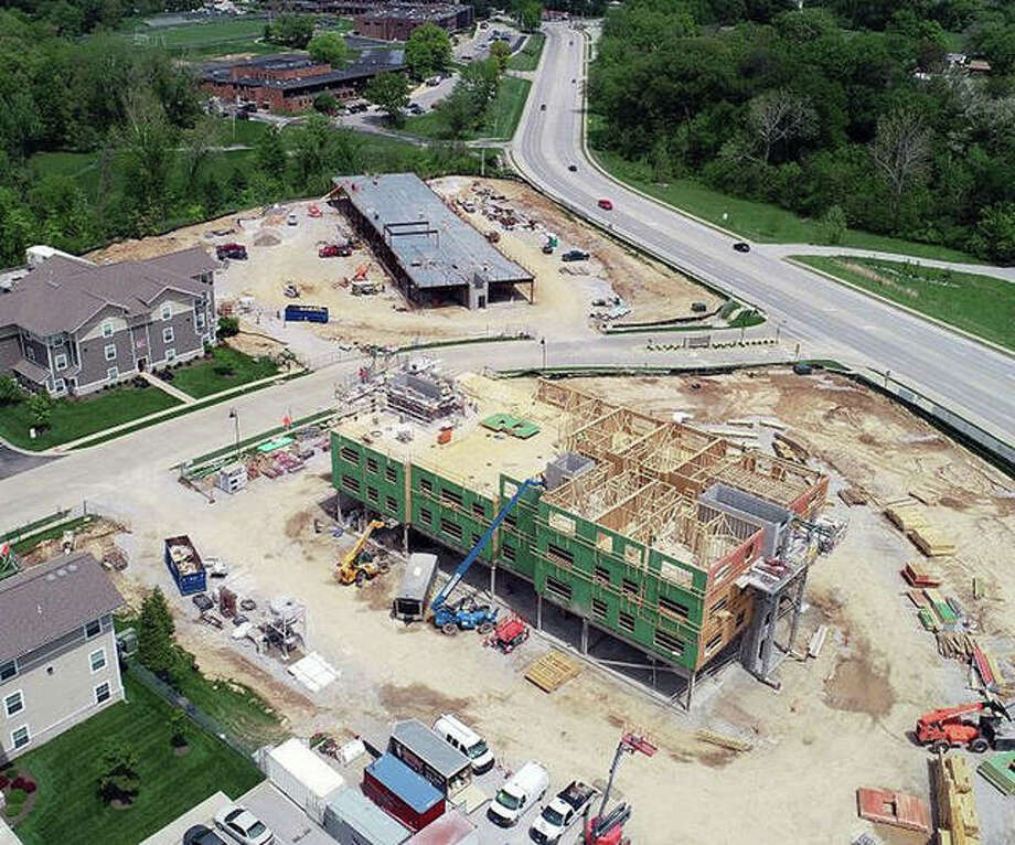This view from a drone is looking east at the Whispering Heights development. In the foreground is the tower scheduled to open in October while its companion in the background is projected to open six months later. Both openings are weather-dependent. Photo: Courtesy Of Holland Construction