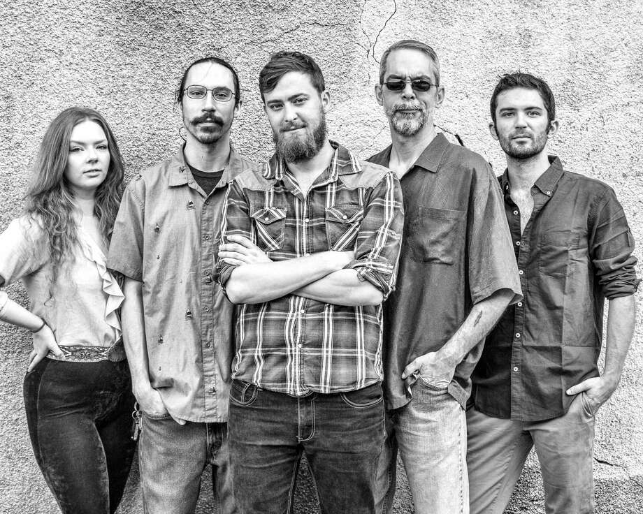Caleb & The Homegrown Tomatoes release their first full-length album on Friday, May 17, at 9 p.m. at The Corner Pub in downtown Conroe. Pictured from left are band members Sara Smith, Stephen Holguin, Caleb Hoelscher, Fred McIntosh and Kacey Bullard. Photo: Courtesy Photo