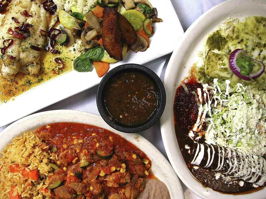 House specialties at SoLuna include huachinango al ajillo, top left, Enchiladas MiraSol and calabacita con carne de puerco. Photo: Mike Sutter /Staff