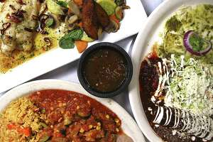 House specialties at SoLuna include huachinango al ajillo, top left, Enchiladas MiraSol and calabacita con carne de puerco.