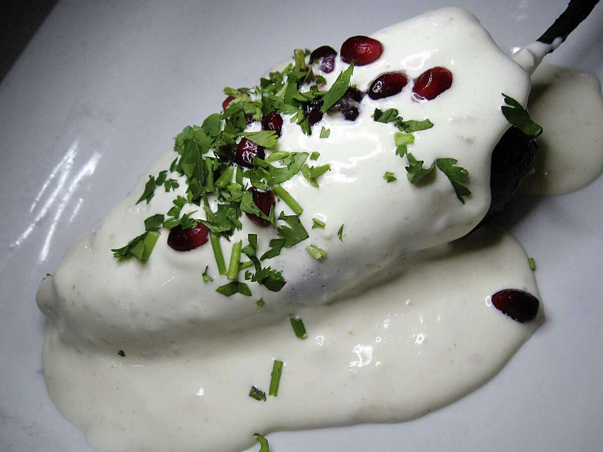 A chile en nogada incorporates beef, pork, almonds, pomegranates and dried fruit in a poblano pepper with almond cream at SoLuna.
