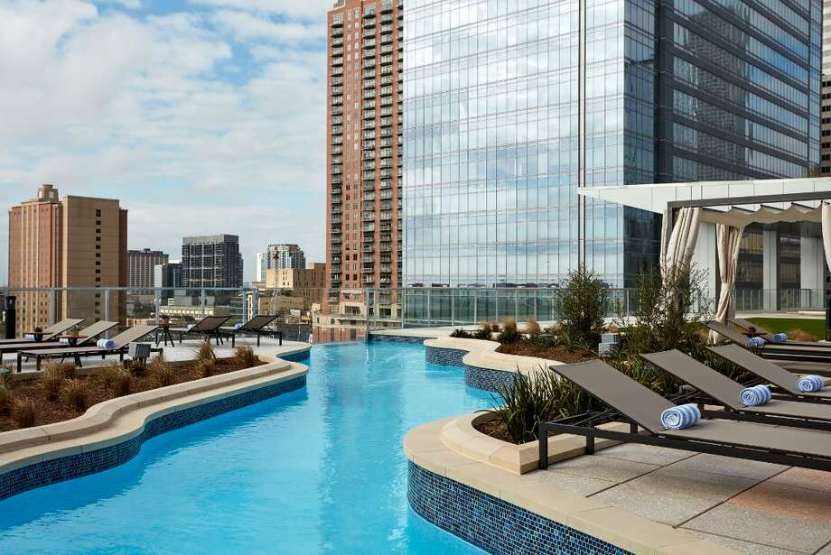 """Marriott Marquis Houston1777 Walker The Texas-shaped lazy river pool is located on the sixth floor of the downtown property. Enjoy live music every Friday and Saturday from May 25 through July 20 from 6 p.m. to 8 p.m. during the hotel's """"Summer Elevated"""" poolside concert series. Hotel guests have full access and during """"Open Deck"""" days (Monday through Thursday; 9:30 a.m. until pool closing), anyone 21 and older can purchase a day pass starting at $50 per person. Photo: Courtesy"""