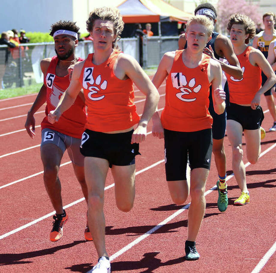 Alton's Cassius Havis (left) runs outside Edwardsville's Roland Prenzler (front) and Jack Pifer on the lead in the 1,600-meter run at the Winston Brown Invite on April 20 in Edwardsville. On Wednesday at the SWC Meet in Collinsville, Havis won the 800 meters and Prenzler was a double-winner in the 1,600 and 3,200. Photo: Greg Shashack / The Telegraph