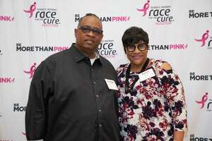 Karen Rayford (right) at the Susan G. Komen Houston's annual dinner event at The Houstonian Hotel on April 16. Standing by Karen is her husband, George.