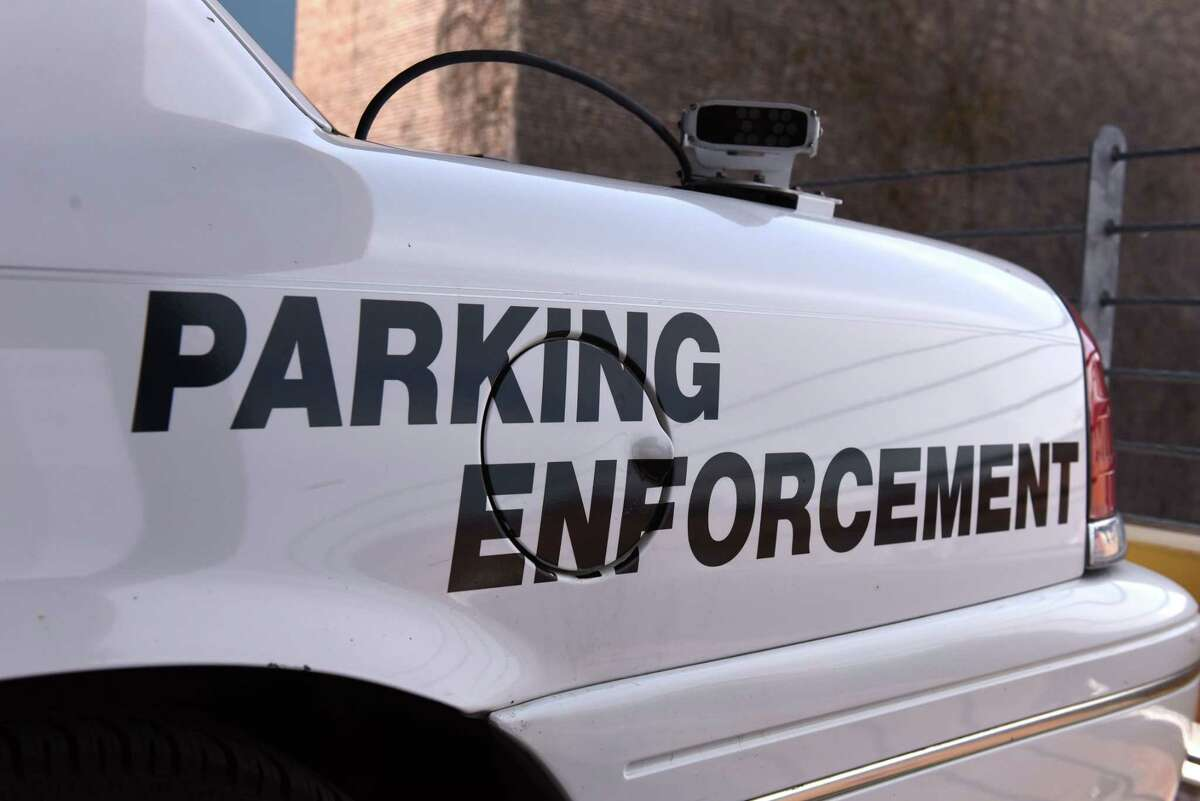 A Troy parking enforcement car is parked in the city-owned 5th Ave. Parking Garage on Thursday, May 9, 2019, in Troy, N.Y. (Will Waldron/Times Union)