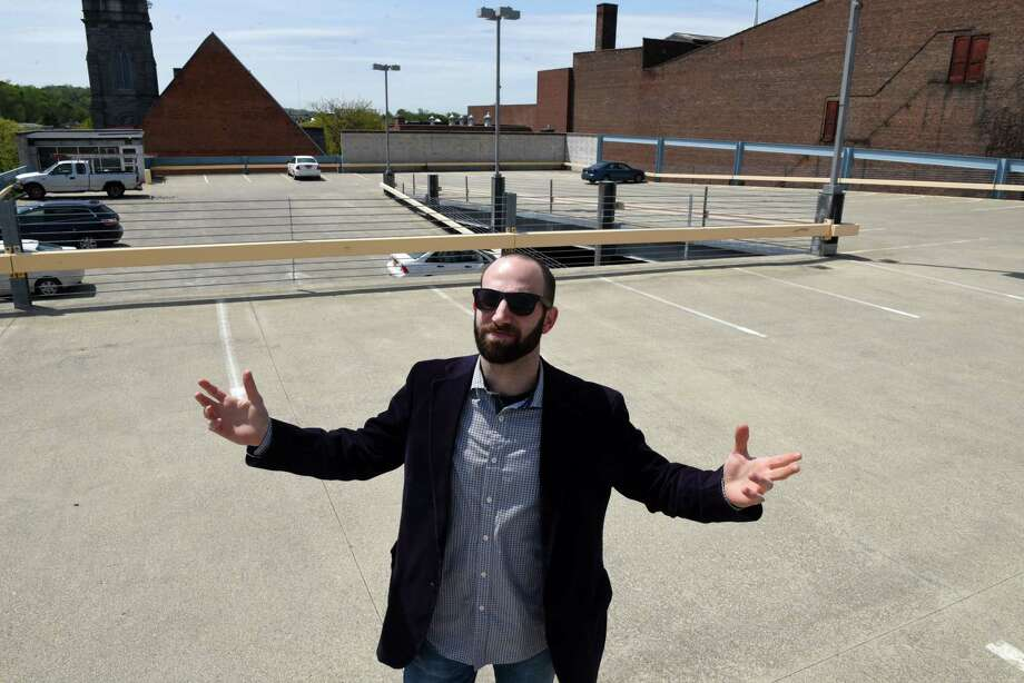 Zack Cohen stands on the top floor of the city-owned 5th Ave. Parking Garage on Thursday, May 9, 2019, in Troy, N.Y. Cohen is fighting back against Troy's downtown parking rules that he says, don't take residents into account.  (Will Waldron/Times Union) Photo: Will Waldron, Albany Times Union