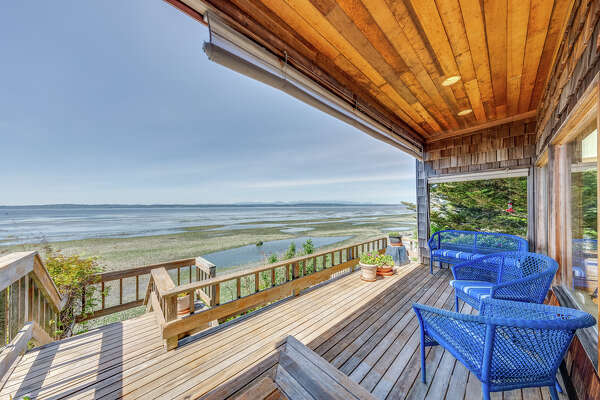 Escape the city in less than 30 minutes with this $2M Magnolia/Queen Anne beach house on the water