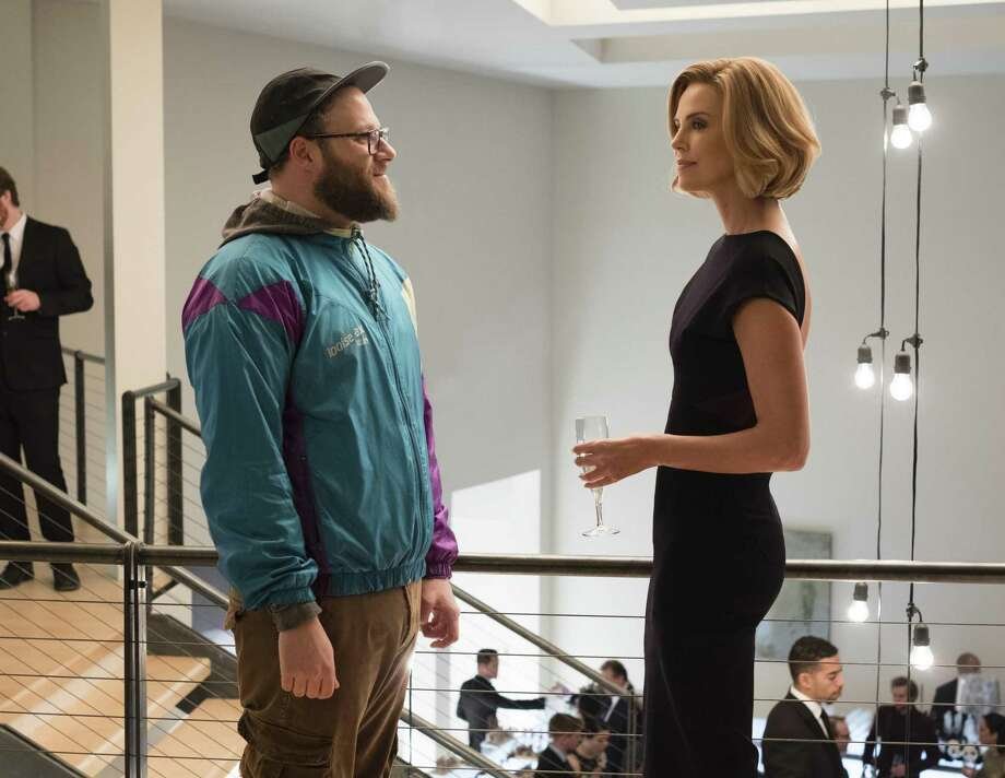 "Seth Rogen, left, and Charlize Theron in a scene from ""Long Shot."" Photo: Philippe Bossé /Lionsgate Via Associated Press / Lionsgate"
