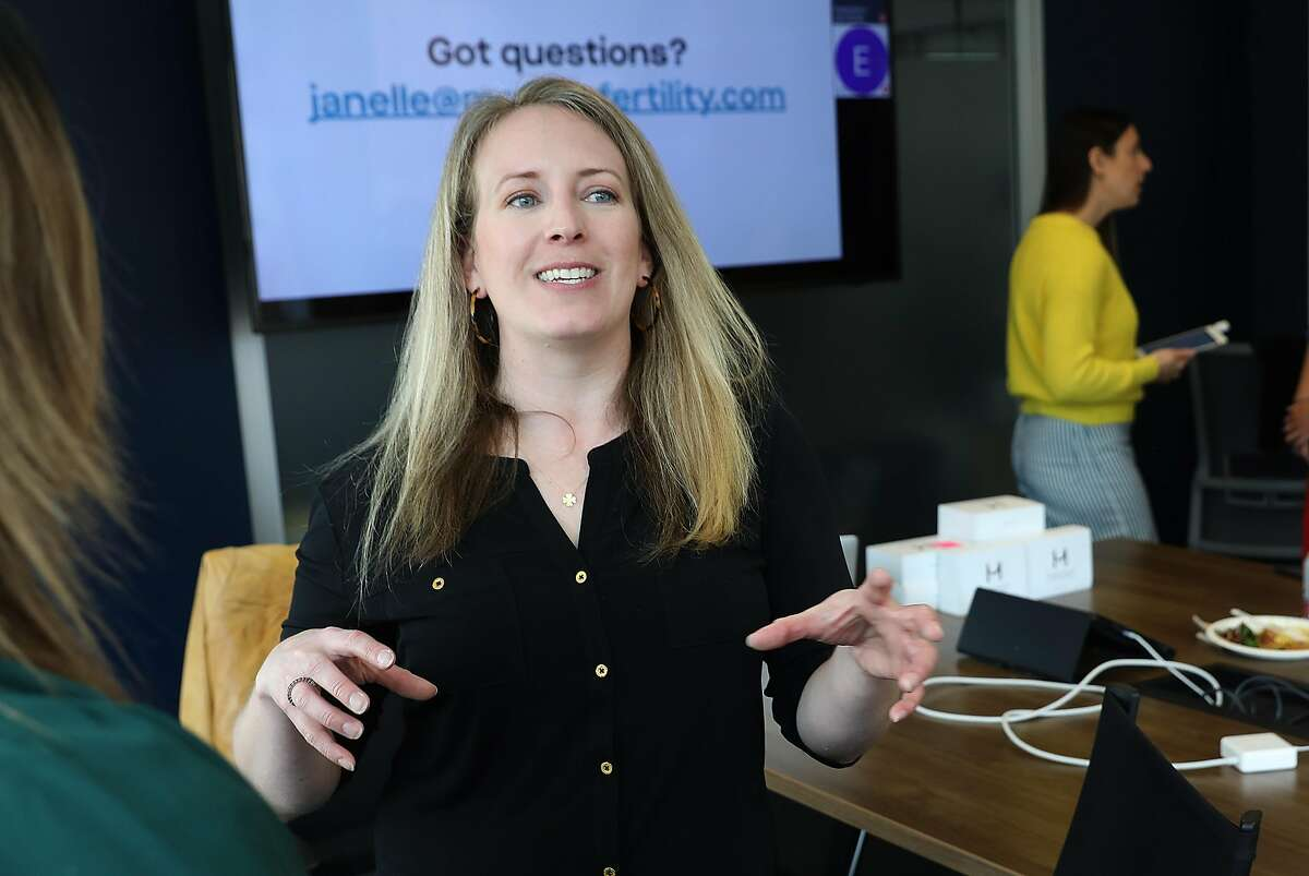 """Dr. Erin Burke talks to employees of Reddit for Modern Fertility after a """"hormone lunch"""" at Reddit headquarters on Tuesday, March 26, 2019, in San Francisco, Calif."""