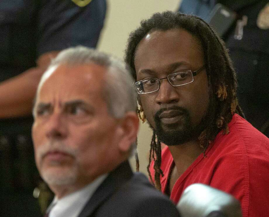 Otis Tyrone McKane, 33,, right, looks around the courtroom Thursday, May 9, 2019, during a bail hearing. McKane is currently waiting trial on one count of capital murder of a police officer, accused of shooting Detective Benjamin Marconi on Nov. 20, 2016. The judge denied bail. Photo: William Luther, Staff Photographer / ©2019 San Antonio Express-News