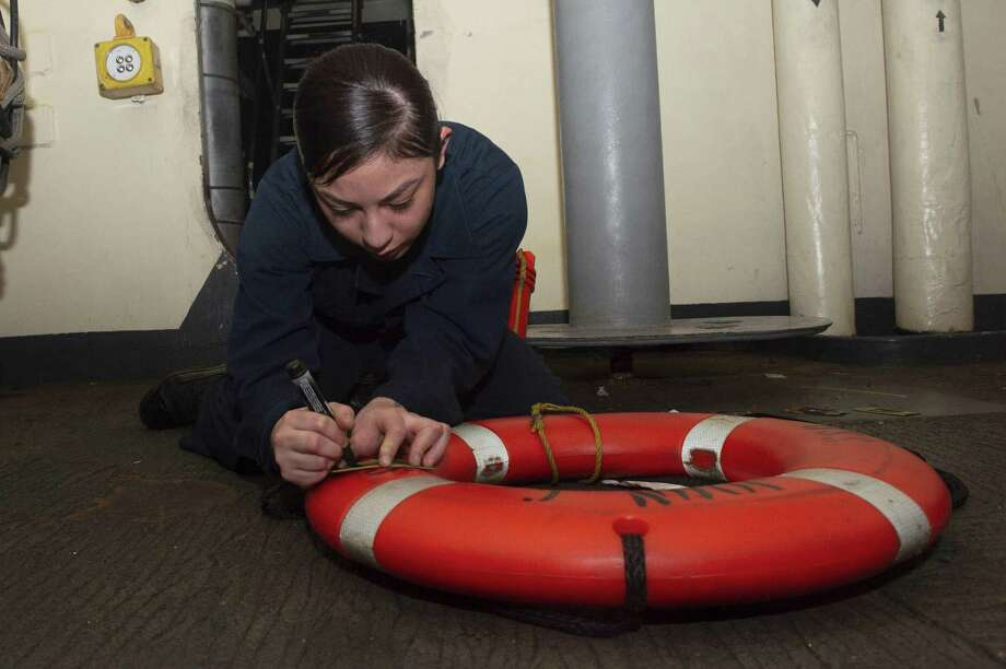 U.S. Navy Boatswain's Mate Seaman Kassandra Lopez, from Houston, stencils a life ring aboard the aircraft carrier USS John C. Stennis (CVN 74) in the Atlantic Ocean, May 7, 2019. The John C. Stennis Carrier Strike Group (JCSCSG) is deployed in support of maritime security cooperation efforts in the U.S. 6th Fleet area of responsibility. Photo: Mass Communication Specialist Seaman Apprentice Jordan Ripley, USS John C. Stennis (CVN 74) / U.S. Navy Photo / Digital