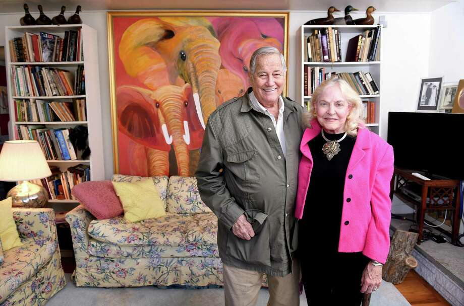 Jim Fowler and his wife, Betsey, photographed at their home in Rowayton on April 1, 2015. In the background is a painting of African elephants titled, Family, by Betsey Fowler. Photo: Arnold Gold / New Haven Register