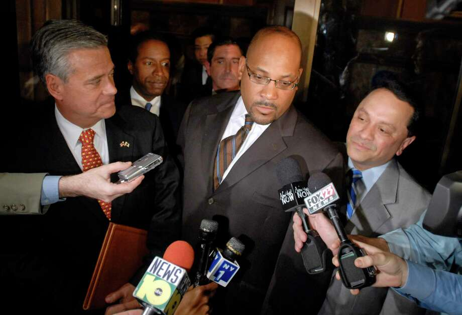 New York state Sens. Dean Skelos, R-Rockville Center, left, John Sampson, D-Brooklyn, center, and Pedro Espada, D-Bronx, right leave the governor's office after negotiations at the Capitol in Albany, N.Y., on Tuesday, July 7, 2009.  Behind them are Sens. Malcolm Smith, D-Queens, left, and Jeffrey Klein, D-Bronx. Photo: Tim Roske, AP / FR61503 AP