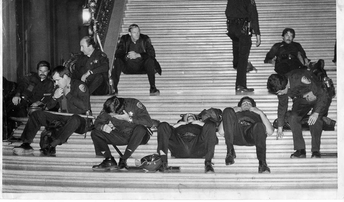 Police rest on the City Hall steps after the White Night riots in the aftermath of the Dan White verdict.