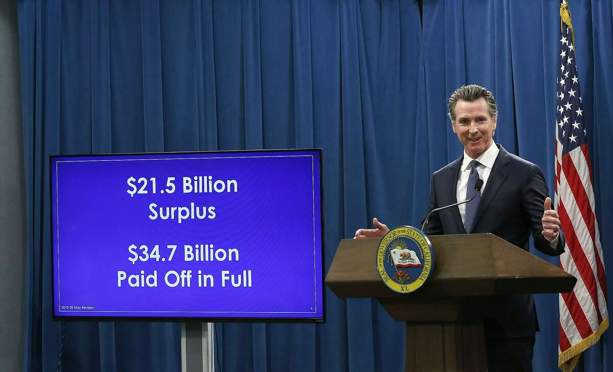 Gov. Gavin Newsom discusses his revised state budget that includes a proposed $21.5 billion surplus during a news conference.