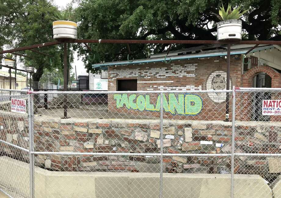 Chain-link fencing encircles the former home of Viva Tacoland at 103 W. Grayson St. The business closed in late April. Photo: Paul Stephen / Staff