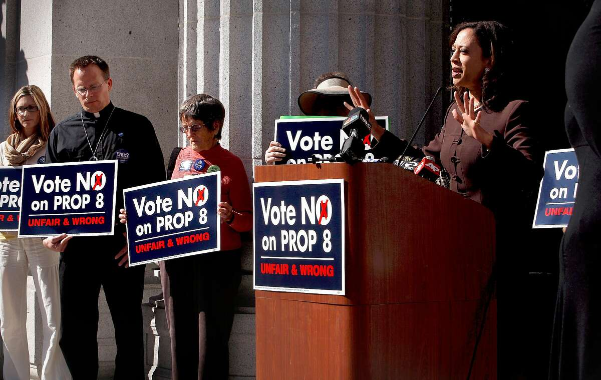 San Francisco District Attorney Kamela Harris speaks during a rally on the steps of City Hall in Oakland, Calif. on Tuesday Oct. 21, 2008, in supporting the defeat of Proposition 8 on the November ballot. Supporters at left are, Darcy Collins, Rev. Michael Schuenemeyer and Mary Strauss.