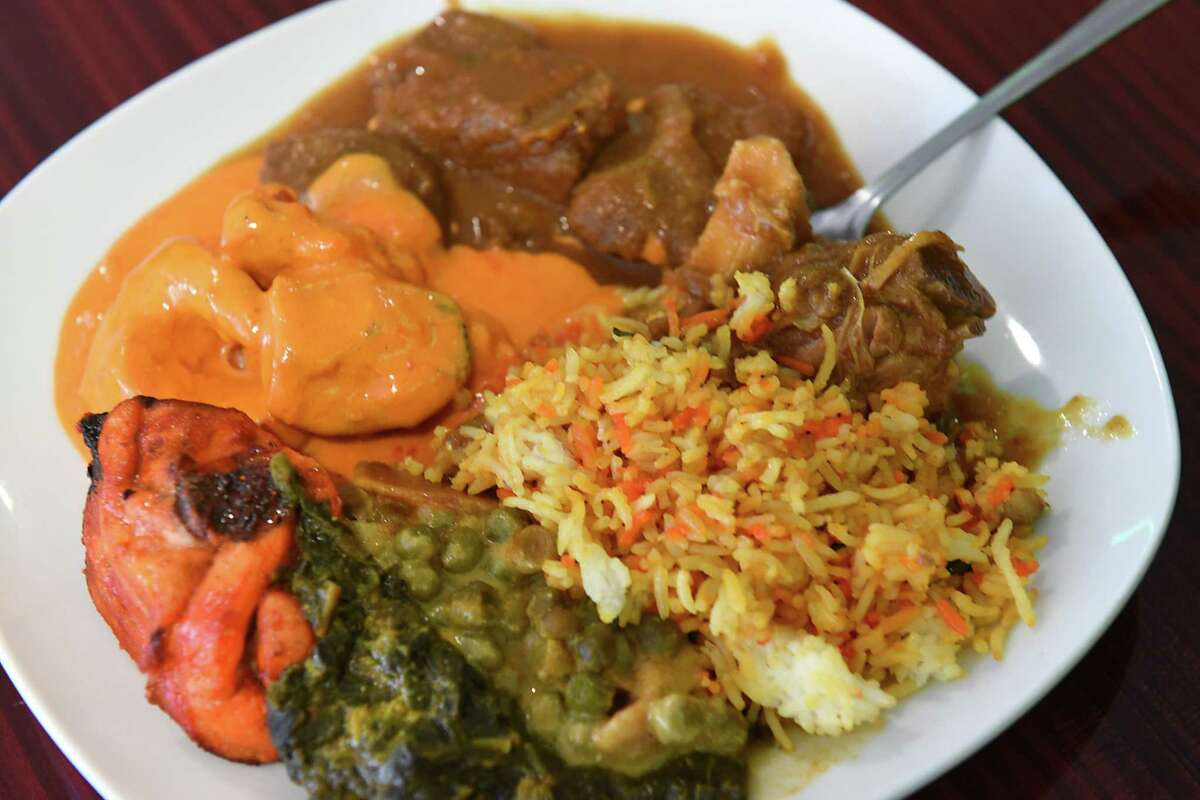 Patrons plate from the buffet at Madina Sweets & Restaurant on Friday, May 3, 2019 in Albany, N.Y. (Lori Van Buren/Times Union)