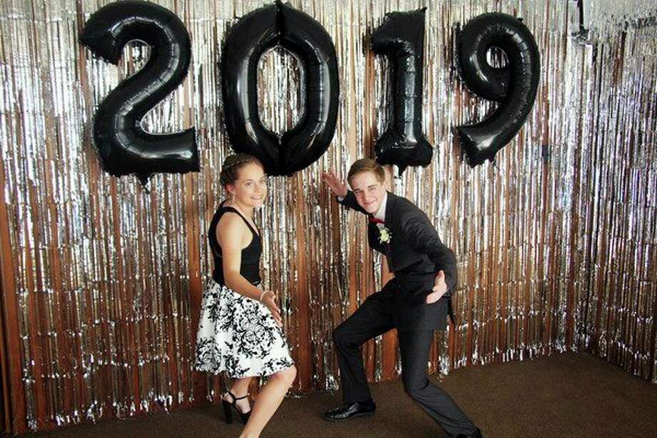 Owendale-Gagetown sophomore Libby Ondrajka and junior Andrew Roemer strike a pose at prom Saturday evening. The school's prom festivities were held at Sherwood on the Hill in Gagetown. For more photos from the event, see Page 8A. (Seth Stapleton/Huron Daily Tribune)