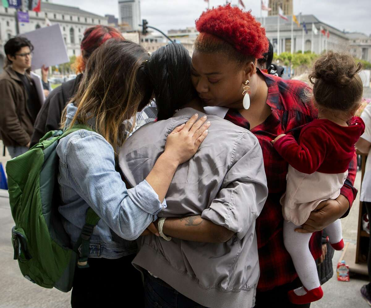 From left: Sam Lew, Sophia Thibodeaux, Danielle Kinnard and her Jeneila Kinnard, age 1, embrace outside City Hall during a protest on Thursday, May 9, 2019, in San Francisco, Calif. Homeless mothers and their supporters rallied to demand the city for housing subsidies, navigation centers and shelter funding for homeless families. Lew is the policy director for the Coalition on Homelessness. Thibodeaux has been homeless for four years. The Kinnard�s along with her other three-year-old son are staying at a shelter for families.