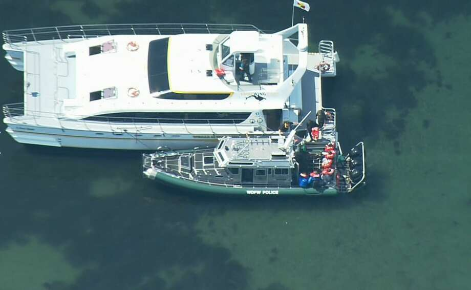 Passengers are rescued from the whale watching boat. Photo: KOMO News/Air 4 Photo