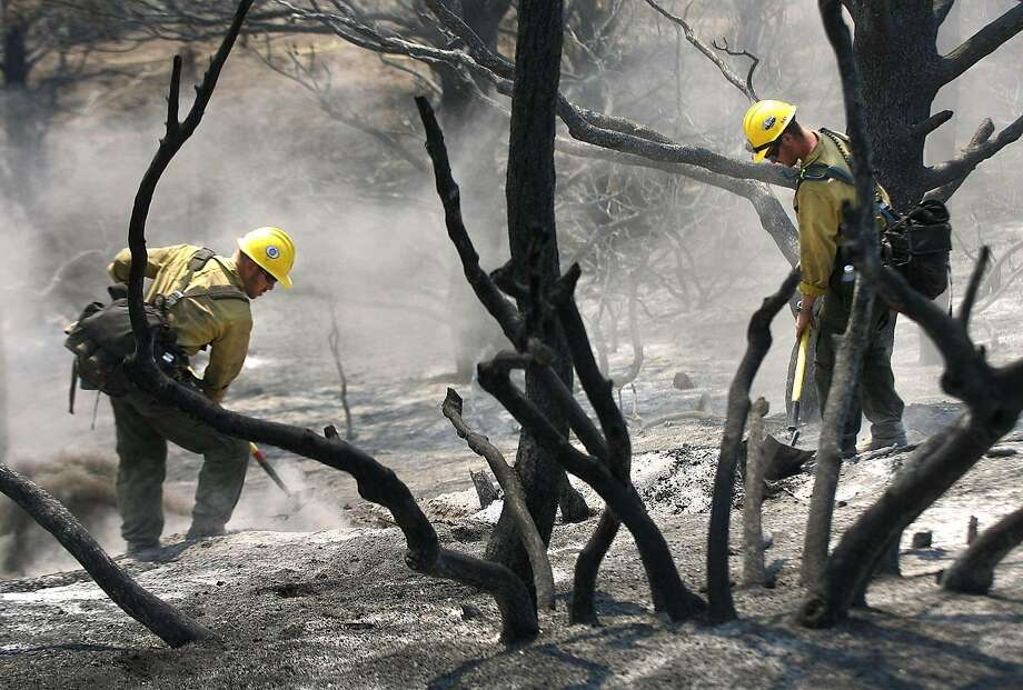 Kern County firefighters check on hot spots, Aug. 22, 2007, during the Zaca Fire in the Los Padres National Forest. Photo: Casey Christie / The Bakersfield Californian / Associated Press