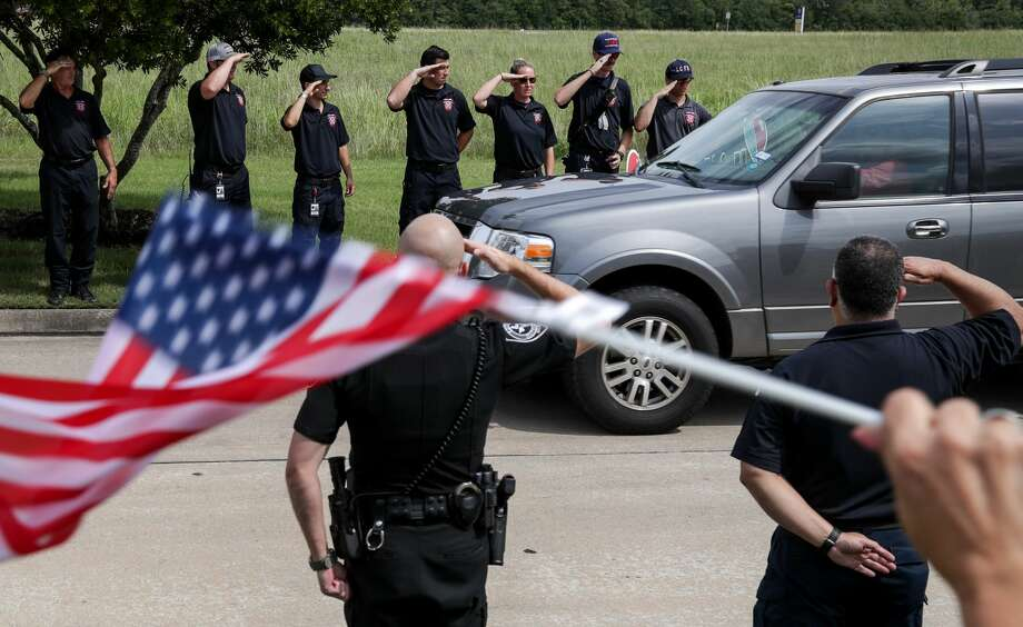 Police officers and firefighters from the Houston area greet John Barnes, the Santa Fe ISD police officer who was shot during the mass shooting at Santa Fe High School, and his wife as they head home after Barnes was released from TIRR on Wednesday, June 20, 2018, in League City. Photo: Jon Shapley/Staff Photographer