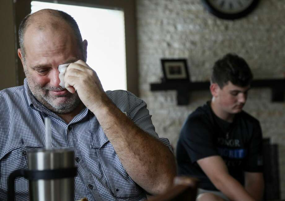 John Barnes, the Santa Fe ISD police officer who was wounded in the mass shooting at Santa Fe High School, cries as his son Luke talks about both how proud he is of his father, and his fears of losing him, after he was released from TIRR on Wednesday, June 20, 2018, in Houston. Photo: Jon Shapley/Staff Photographer