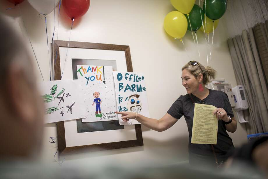 Ashley Barnes jokes about artwork decorating her husbands room before his surgery on Wednesday, June 27, 2018, in League City. Photo: Jon Shapley/Staff Photographer