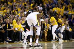 OAKLAND, CALIFORNIA - MAY 08:   Kevin Durant #35 of the Golden State Warriors grabs his ankle after injuring himself against the Houston Rockets during Game Five of the Western Conference Semifinals of the 2019 NBA Playoffs at ORACLE Arena on May 08, 2019 in Oakland, California.  NOTE TO USER: User expressly acknowledges and agrees that, by downloading and or using this photograph, User is consenting to the terms and conditions of the Getty Images License Agreement.  (Photo by Ezra Shaw/Getty Images)