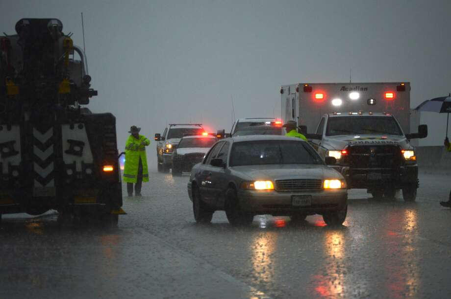 Emergency officials work a wreck on Interstate 10 near FM 1442 during a rain storm on Thursday. Photo: Photo Provided By Eric Williams