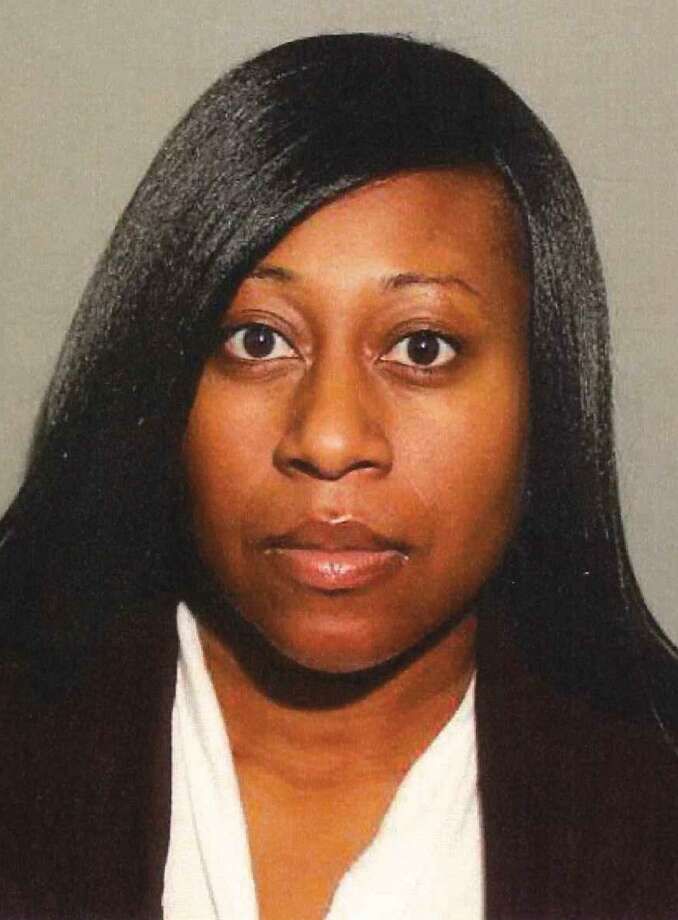 New Canaan Police allege that social worker Kelly Howard, 32, of Ansonia, provided a juvenile in her care with marijuana and vape pods, and failed to report possible cases of abuse and neglect. Photo: Contributed Photo / New Canaan Police / Connecticut Post