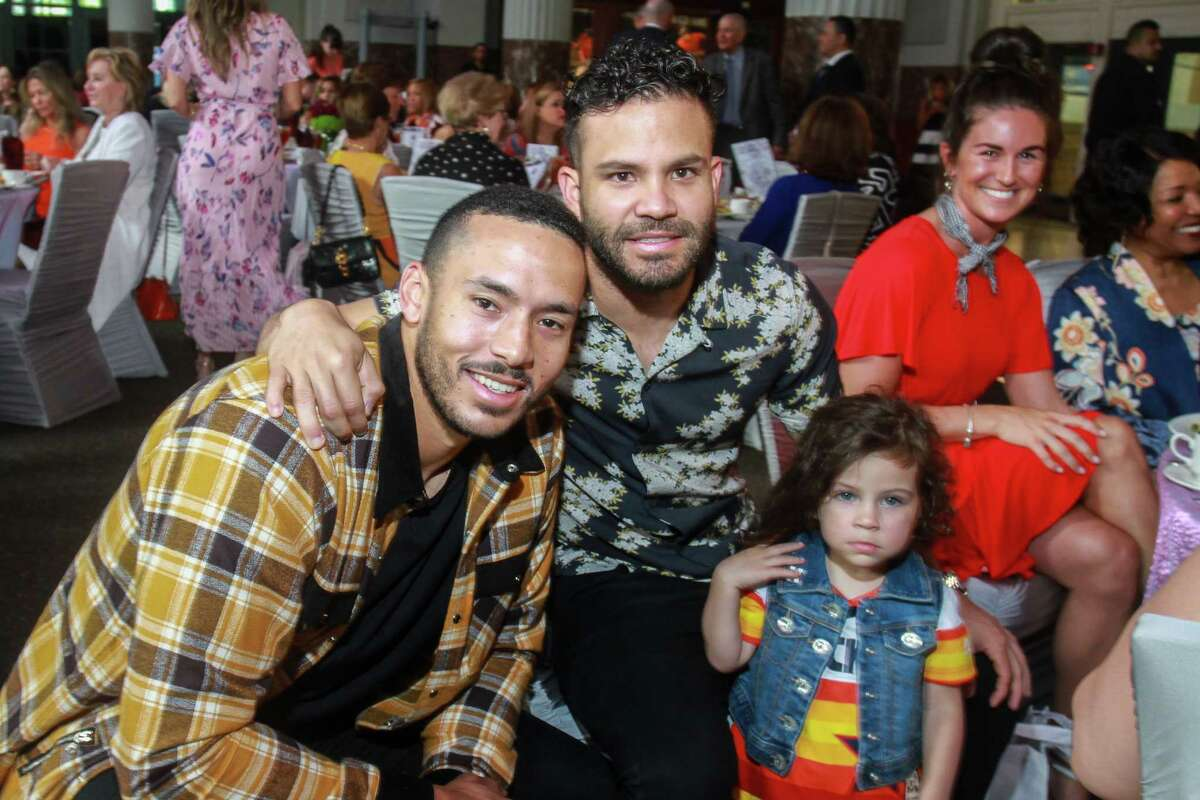 Carlos Correa, left, with Jose Altuve and Altuve's daughter, Melanie at the Astros Foundation's Safe at Home Luncheon and Style Show.